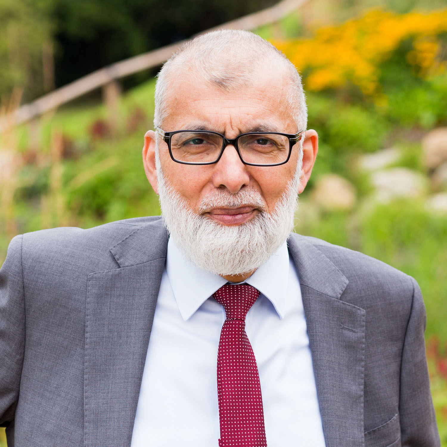Natural background profile photo of doctor in garden of care home in North Wales