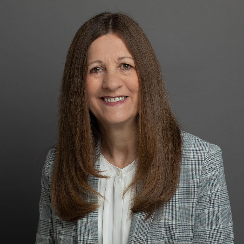 Dark background headshot of woman